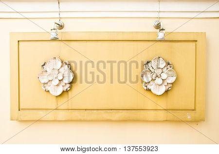 sandstone wall with stone sculpture flower craft art design