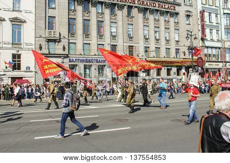 St. Petersburg, Russia - 9 May, Soldiers under three Soviet flags, 9 May, 2016. Memory Action