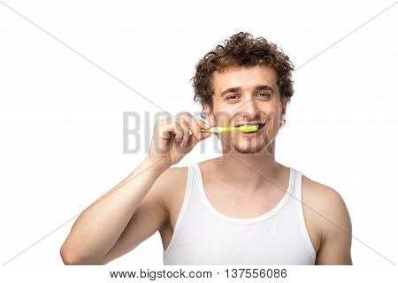 Curly Guy Brushing His Teeth