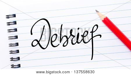 Debrief Written On Notebook Page