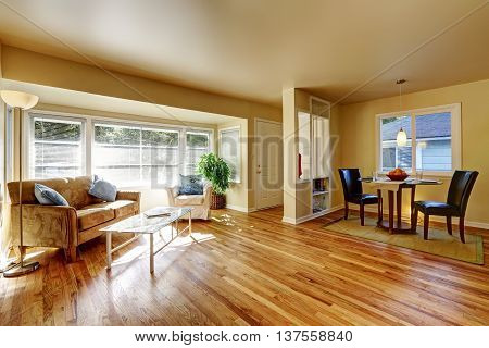 Open Dining Room With Hardwood Floor Connected To Dining Room
