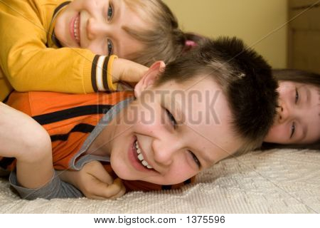 Kids Playing On The Floor