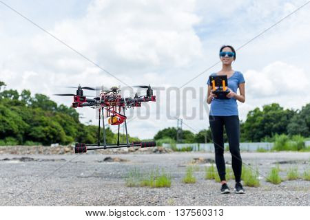 Asian woman use drones in the outdoor
