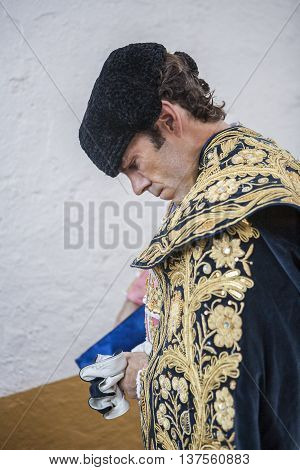 Linares SPAIN - August 29 2014: Spainish bullfighter Jose Tomas putting itself the walk cape in the alley before going out to bullfight typical and very ancient tradition in Linares Jaen province Spain