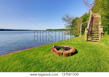 Backyard Area With Wonderful Water View And Fire Pit.