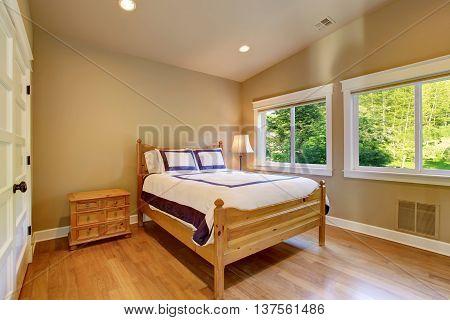 Simple Beige Bedroom With Nightstand, Hardwood Floor And Two Windows.