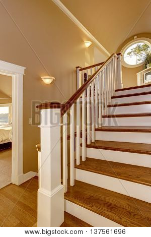House Interior. Hallway With Wooden Staircase And White Railings.
