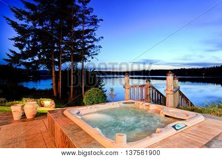 Awesome Water View With Hot Tub At Dusk In Summer Evening.