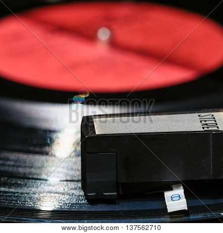 Headshell On Vinyl Record In Old Turntable
