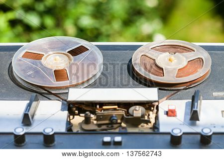 Shabby Reel-to-reel Recorder Outdoors