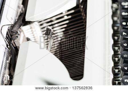 Typebar Operates In Mechanical Typewriter