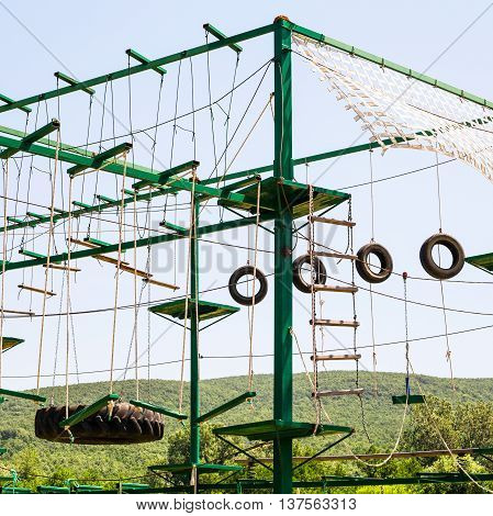 rope-ladders in outdoor obstacle course in sunny summer day