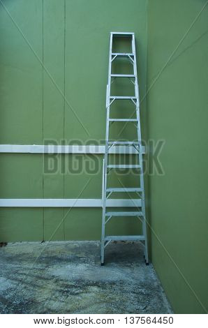 Aluminum step ladder in home on green backagound
