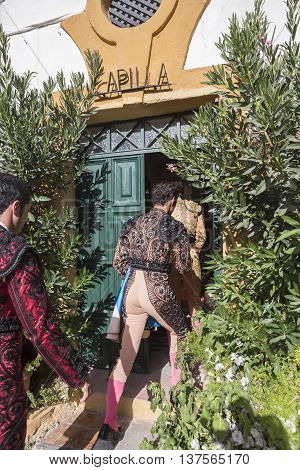 Linares Spain - August 28 2014: The Spanish Bullfighters enter chapel before starting bullfight tradition ancestral and religion in the world of bullfighting rite typical Spanish in Bullring of Linares Spain