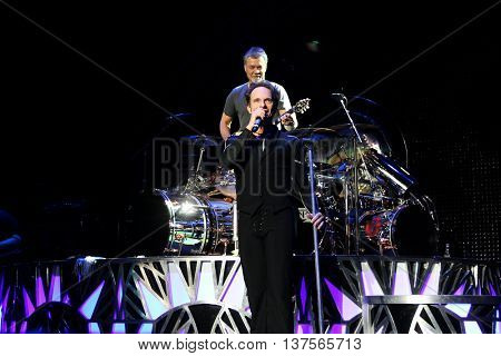 WANTAGH, NY-AUG 14: Eddie Van Halen (top) and David Lee Roth of Van Halen perform onstage at Jones Beach Theater on August 14, 2015 in Wantagh, New York.