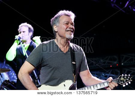 WANTAGH, NY-AUG 14: David Lee Roth (L) and Eddie Van Halen of Van Halen perform onstage at Jones Beach Theater on August 14, 2015 in Wantagh, New York.