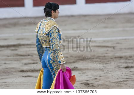 Linares SPAIN - August 28 2011: The Spanish Bullfighter Miguel Angel Perera bullfighting with the crutch in the Bullring of Linares Spain