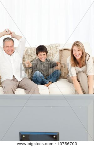 A little boy with his grandparents  in the living room at home