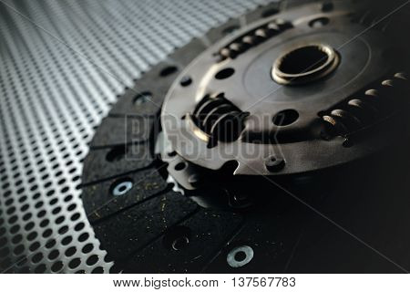 Car clutch on a metal surface. Photo from the classical vignetting effect it and a small depth of field