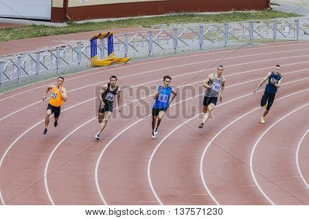 Chelyabinsk Russia - July 01 2016: running men athletes at sprint distance of 200 meters during Ural championship in athletics