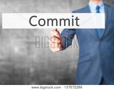 Commit - Business Man Showing Sign