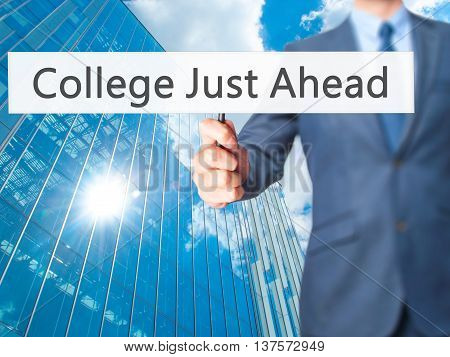 College Just Ahead - Business Man Showing Sign