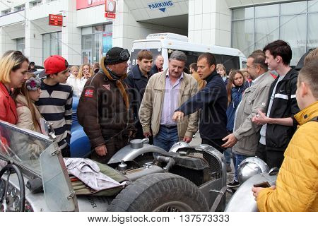 PERM RUSSIA - JUNE 29: Rally of retro-cars Peking-Paris 2016 June 29 2016 in Perm Russia. Party rally discusses car charger with residents