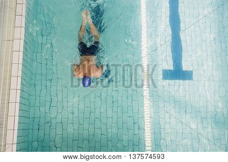 Swimmer doing the breaststroke in swimming pool at leisure center