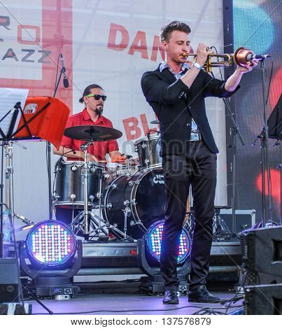 St. Petersburg, Russia - 2 July, Trumpet player and drummer,  2 July, 2016. Annual international festival of jazz and blues in St. Petersburg.