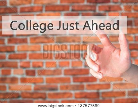 College Just Ahead  - Hand Pressing A Button On Blurred Background Concept On Visual Screen.