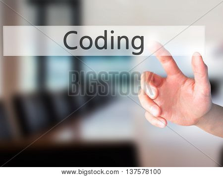 Coding - Hand Pressing A Button On Blurred Background Concept On Visual Screen.