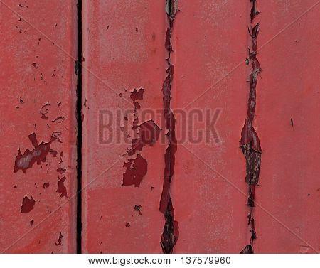 Old wooden door covered in faded, peeling paint.