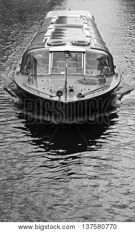 Black and white Amsterdam boat on canal