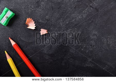 School Supplies On The Left Side On A Blackboard