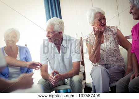 Seniors interacting in the retirement house