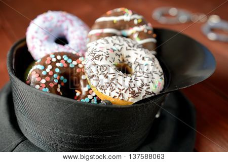 Police brekfast, a hat full of colorful donuts