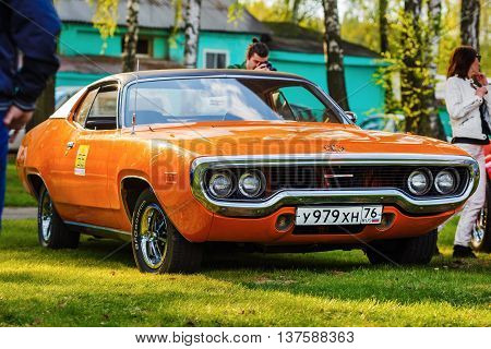 MINSK BELARUS - MAY 07 2016: Orange Plymouth Satellite 1971 model year. A new design was introduced for the 1971 model year. Classic vintage car.