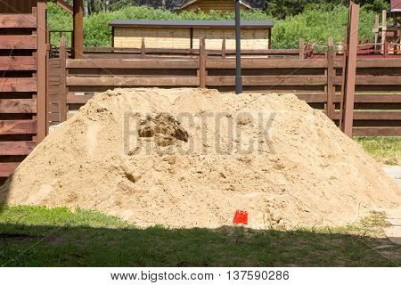 Pile Of Quarry Sand Lies On The Grass