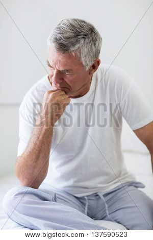 Close-up of worried senior man at home