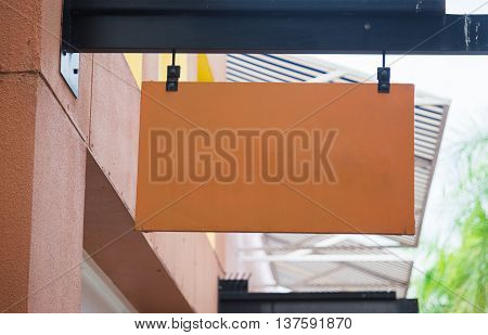 Blank brown billboard with copy space for your text message or promotional content public information board on the street advertising mock up empty banner clear poster.