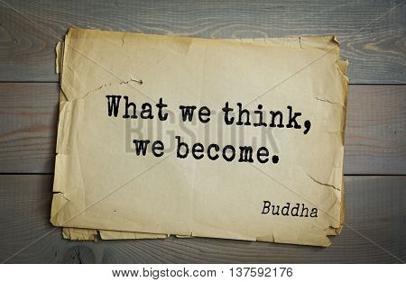 Buddha quote on old paper background. What we think, we become.