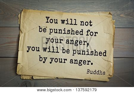 Buddha quote on old paper background. You will not be punished for your anger, you will be punished by your anger.
