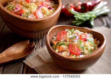 Chinese cabbage salad with carrot, red onion and apples