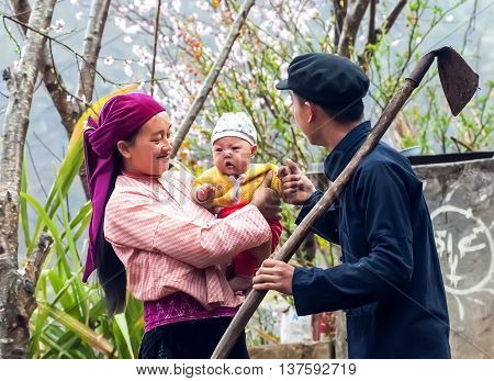 HA GIANG, VIETNAM, February 4, 2016 the couple, ethnic Hmong with happy little children, in the spring, highland Ha, Vietnam