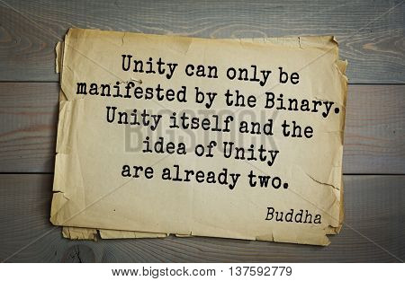 Buddha quote on old paper background. Unity can only be manifested by the Binary. Unity itself and the idea of Unity are already two.