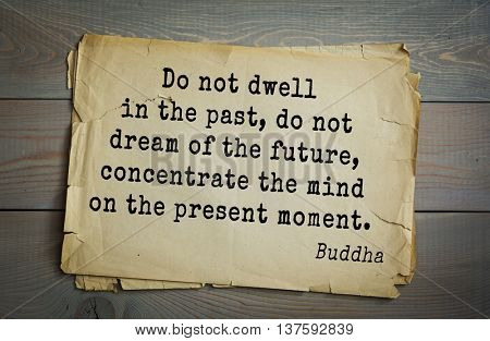 Buddha quote on old paper background. Do not dwell in the past, do not dream of the future, concentrate the mind on the present moment.