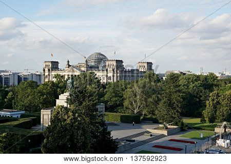 Close-up view of historic Reichstag (Deutscher Bundestag) building, seat of the German Parliament, in golden evening light during sunset, Berlin Mitte quarter , Germany