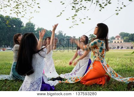 HA NOI, VIET NAM, March 18, 2016 a group of students, Ha Noi, wearing traditional dress, playing outside, ruins, Hoang Thanh Thang Long, Ha Noi