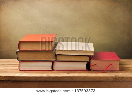 Vintage books on wooden table. Climbing stairs to knowledge concept.