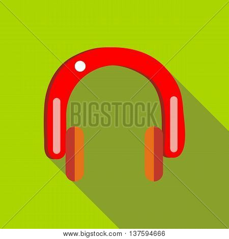 Red headphones icon in flat style on a green background